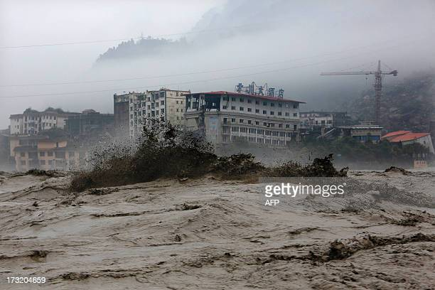 This picture taken on July 9 2013 shows heavy flood waters sweeping through Beichuan in southwest China's Sichuan province Rainstorms sweeping across...