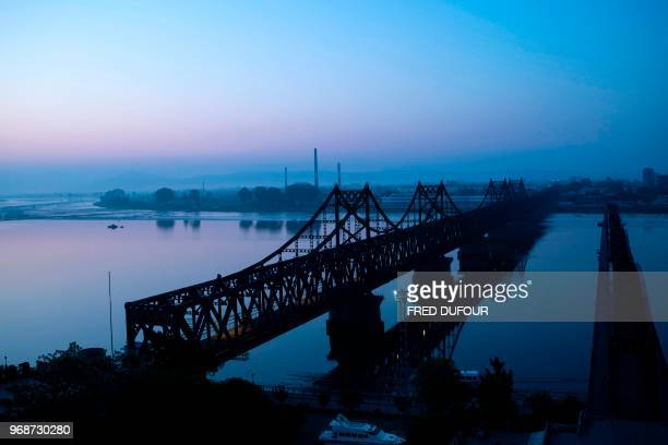 This picture taken on June 1 2018 shows the Friendship Bridge and the Broken Bridge seen from the border city of Dandong in China's northeast...