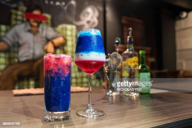 TOPSHOT This picture taken on June 1 2018 shows the US President Donald Trump and North Korean leader Kim Jong Un themed cocktails at a bar in...