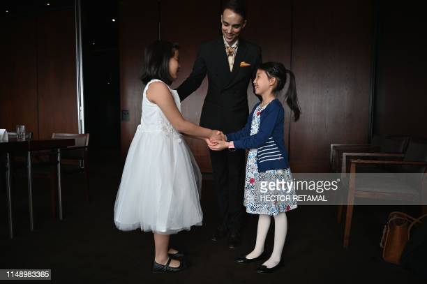 This picture taken on June 1 2019 shows Guillaume de Bernadac teaching children how greet each other during an etiquette and manners class in central...