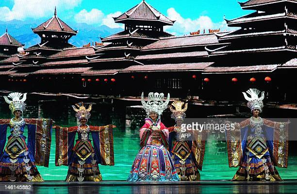 This picture taken on June 10 shows Chinese ethnic minority dancers performing a song and dance routine entitled 'Colourful Guizhou' in Guiyang...