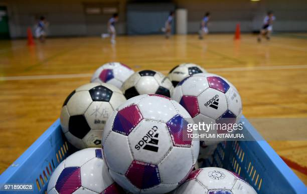 This picture taken on June 11 2018 shows elementary school children attending a kids soccer school class at Konami Sports Club headquarters in Tokyo...