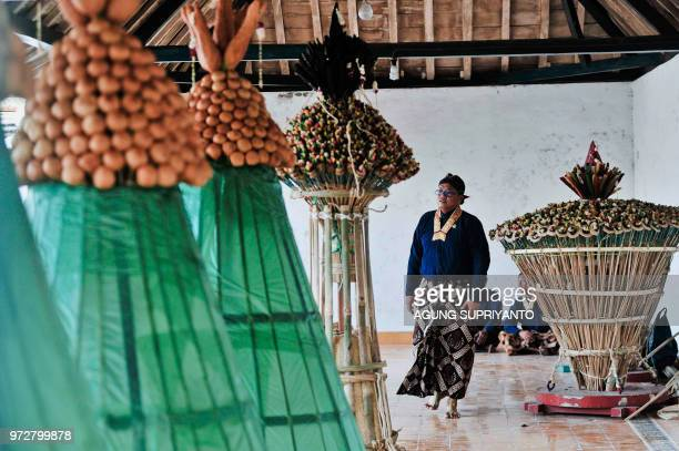 This picture taken on June 12 2018 shows palace servants of the Sultan of Yogyakarta taking part in the Tumplak Wajik ceremony to prepare the...