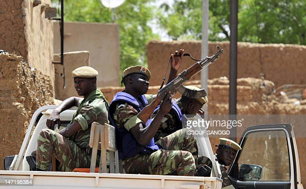 This picture taken on June 13 2012 shows Burkinabe soldiers sitting in a patrol pickup car in GoromGorom northern Burkina Faso All important persons'...