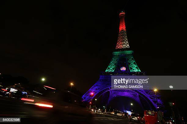 TOPSHOT This picture taken on June 13 2016 shows the Eiffel Tower in Paris illuminated in rainbow colours to pay homage to the victims of a shooting...