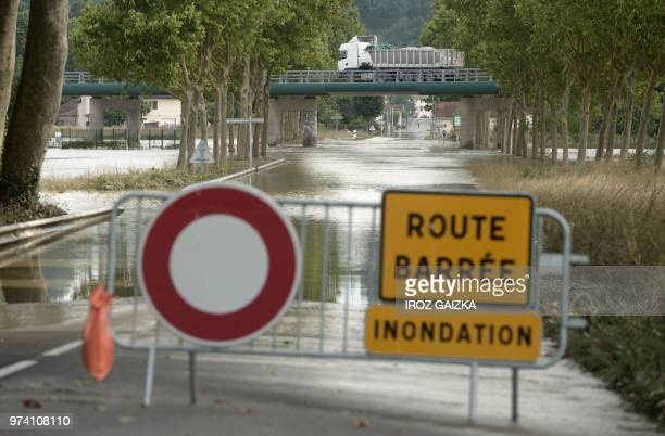 This picture taken on June 14 2018 shows a closed road following heavy rains in Peyrehorade in the region of Landes France