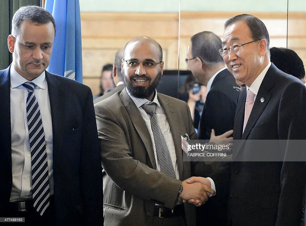 This picture taken on June 15, 2015 shows member of the delegation of the Yemeni government in exile Abdel Wahab al-Humayqani (C) shaking hands with United Nations (UN) General Secretary Ban Ki-moon (R), as the UN special envoy Ismail Ould Cheikh Ahmed looks on, after a meeting on Yemen peace talks at the UN offices in Geneva. al-Humayqani, leader of a Salafist Islamist party in Yemen, who is designated on a list of the US Department of Treasury for allegedly having financial links with Al-Qaeda, is part of the delegation of the Yemeni government in exile at the peace talks with the United Nations in Geneva that opened on June 15.
