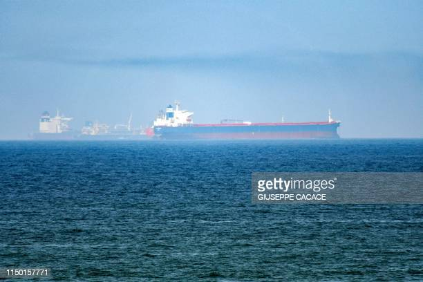 TOPSHOT This picture taken on June 15 2019 shows tanker ships in the waters of the Gulf of Oman off the coast of the eastern UAE emirate of Fujairah