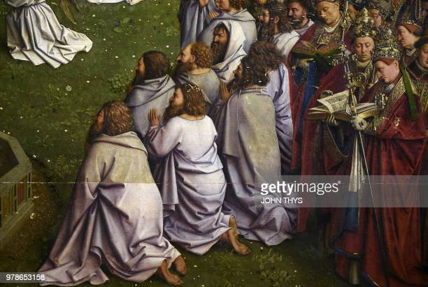 This picture taken on June 19 2018 shows part of the restored original of 'Adoration of the Mystic Lamb' altarpiece by Van Eyck brothers at the art...