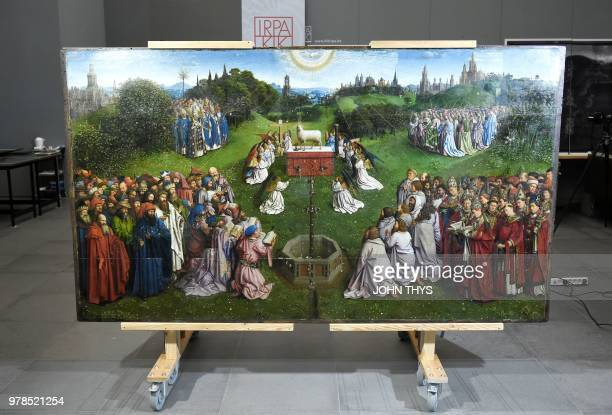This picture taken on June 19 2018 shows the restored original of 'Adoration of the Mystic Lamb' altarpiece by Van Eyck brothers at the art gallery...