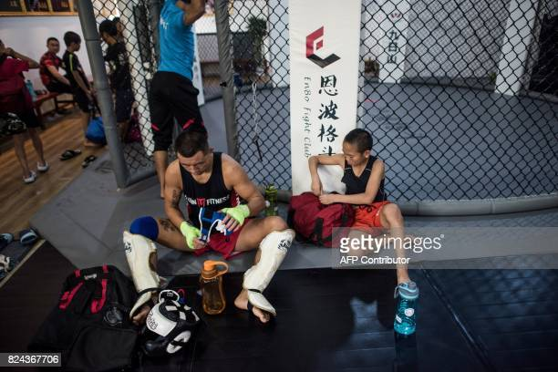 This picture taken on June 2 2017 shows a boy preparing to start participating in a training session at the Enbo Fight Club in Chengdu Though most of...