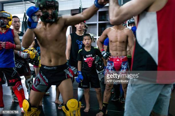 This picture taken on June 2 2017 shows a mixed martial arts training session at the Enbo Fight Club in Chengdu / AFP PHOTO / Fred DUFOUR
