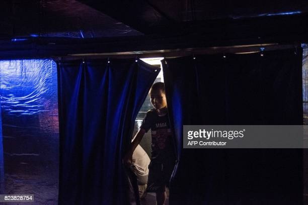 This picture taken on June 2 2017 shows Abieamu looking at the audience before fighting in an underground fight club in Chengdu Abieamu is among the...