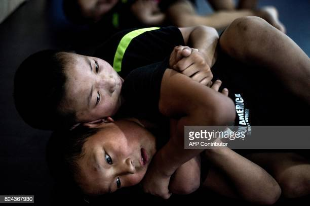 This picture taken on June 2 2017 shows children fighting during a training session at the Enbo Fight Club in Chengdu Though most of the Enbo fight...