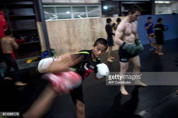 This picture taken on June 2 2017 shows children practising mixed martial arts during a training session at the Enbo Fight Club in Chengdu Though...