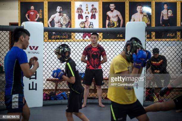 This picture taken on June 2 2017 shows children taking part in mixed martial arts training at the Enbo Fight Club in Chengdu / AFP PHOTO / Fred...