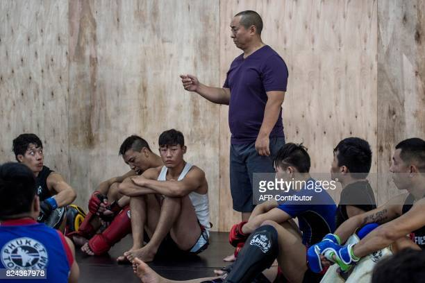 This picture taken on June 2 2017 shows Enbo Fight Club's Tibetan founder En Bo speaking during a training session at club in Chengdu Though most of...