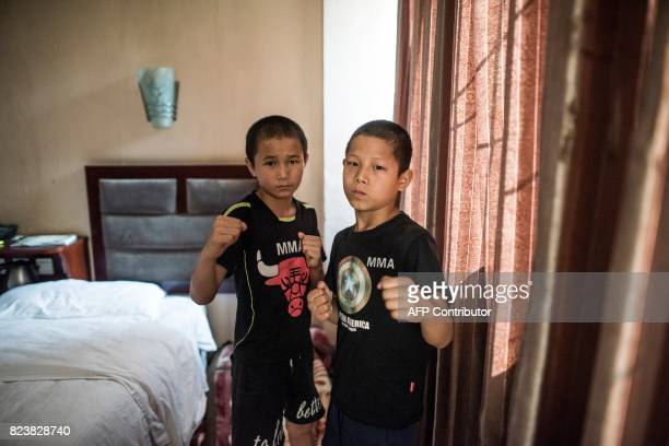 This picture taken on June 2 2017 shows Jihushuojie and Abieamu posing in their hotel room before fighting at an underground fight club in Chengdu...