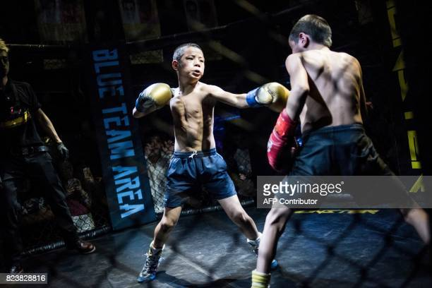 This picture taken on June 2 2017 shows Jihushuojie and Abieamu fighting in an underground fight club in Chengdu Abieamu and Jihushuojie are among...