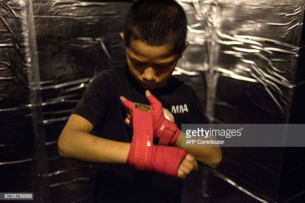 This picture taken on June 2 2017 shows Jihushuojie preparing for a fight in an underground fight club in Chengdu Jihushuojie is among the kids from...