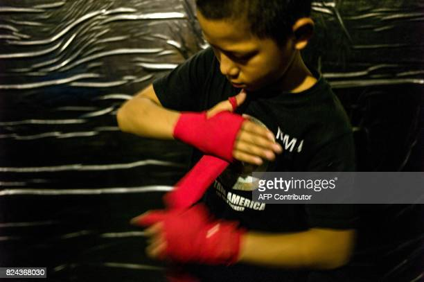 This picture taken on June 2 2017 shows Jihushuojie preparing to fight in an underground fight club in Chengdu Jihushuojie is among the kids from the...