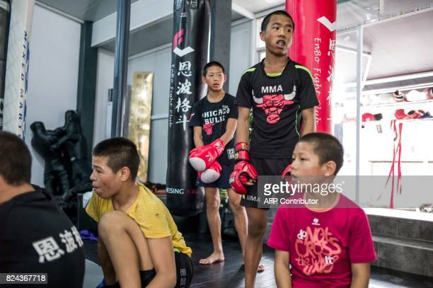 This picture taken on June 2 2017 shows participants at a training session at the Enbo Fight Club in Chengdu Though most of the Enbo Fight Club's...