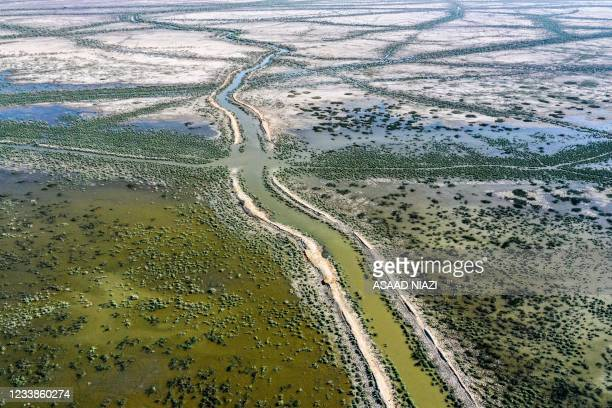 This picture taken on June 20, 2021 shows an aerial view of drying earth in the Chibayesh marshland in Iraq's southern Ahwar area. - As Iraq bakes...