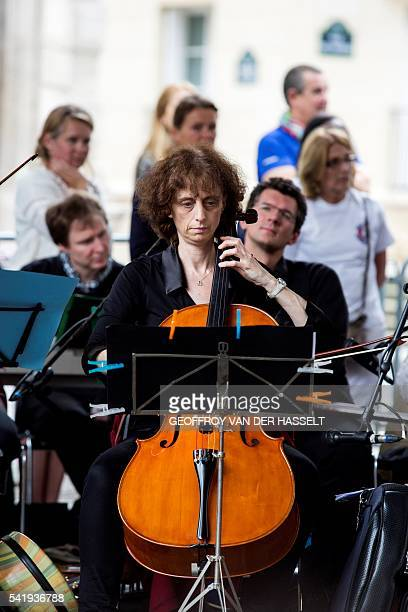 This picture taken on June 21 2016 in Paris shows musicians playing in the streets of Paris as part of the Make Music Day France's annual summer...