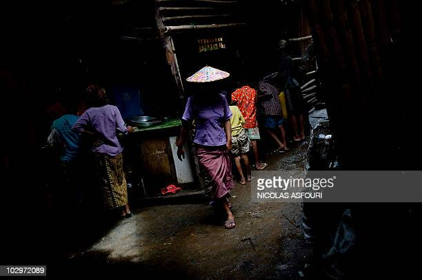 This picture taken on June 23 2010 shows refugees inside the Mae La refugee camp around 90 km from Mae Sot on the ThaiMyanmar border Almost 140000...
