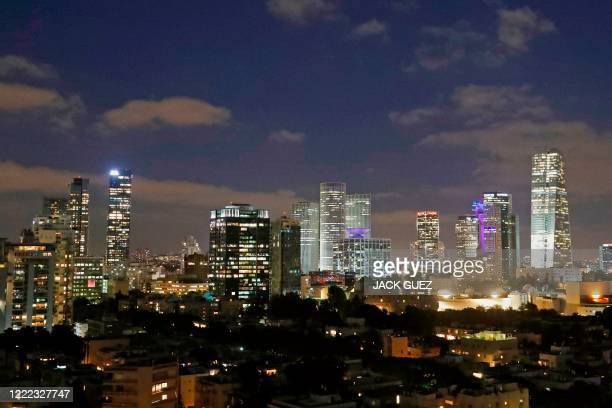 This picture taken on June 23, 2020 shows a general view of the skyline of buildings in Israel's Mediterranean coastal city of Tel Aviv in the early...