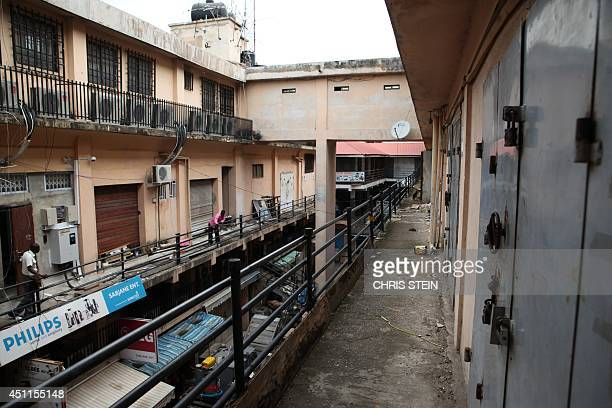 This picture taken on June 24 2014 shows closed shops in Ghana's capital Accra as a major traders' union launched a fourday strike to protest against...