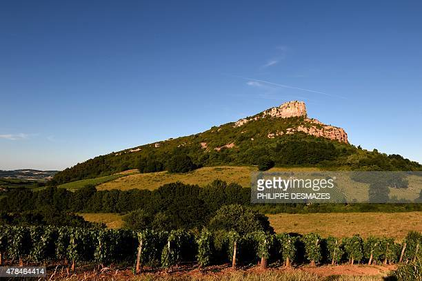 This picture taken on June 24 2015 shows La Roche de Solutre a limestone escarpment located at 8 km west of Macon The rock which overlooks the town...