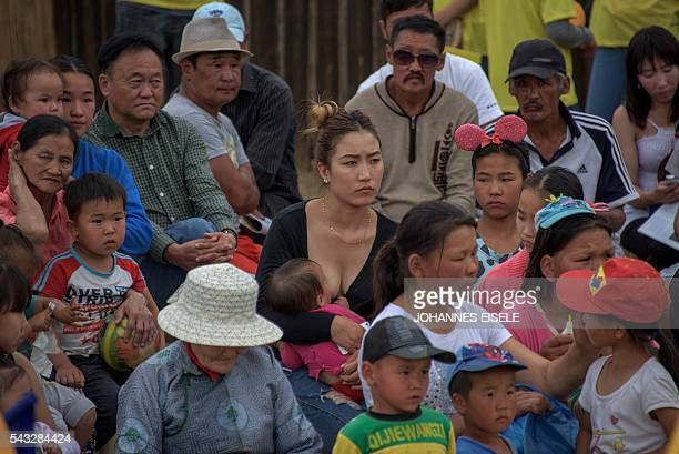 This picture taken on June 25 2016 shows people attending a candidate's campaign rally ahead of a general election in Mongolia's capital Ulan Bator...