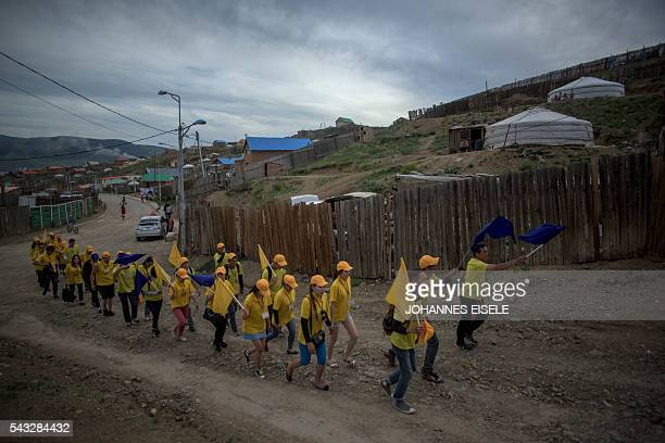 This picture taken on June 25 2016 shows people taking part in a candidate's campaign rally ahead of a general election in Mongolia's capital Ulan...