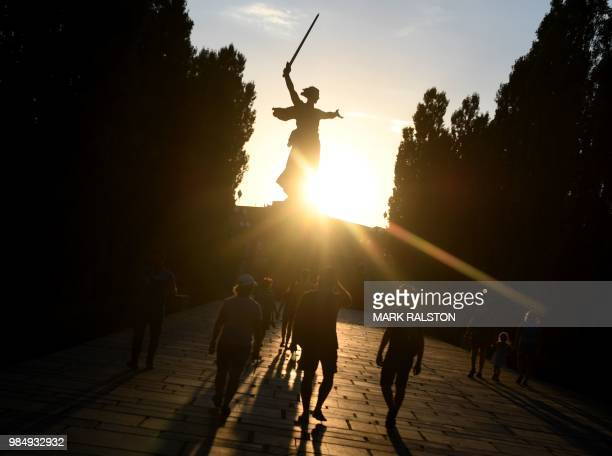 This picture taken on June 26 2018 shows people visiting the Motherland Calls statue at the Mamayev Kurgan World War II memorial complex in Volgograd...