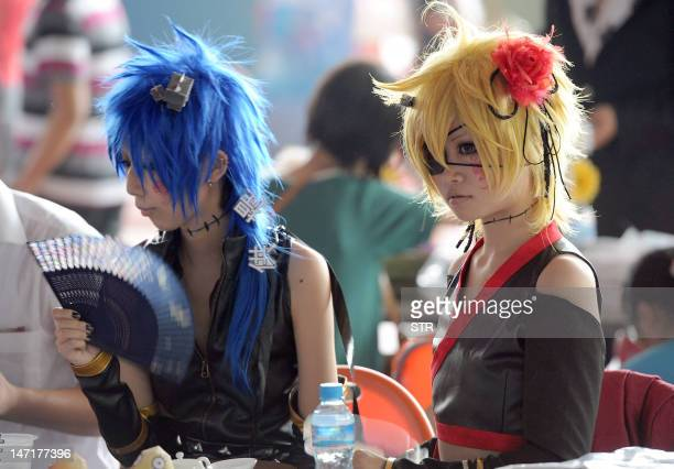 This picture taken on June 26 shows two Chinese girls dressed in cosplay at a cosplay gathering in Hefei east China's Anhui province Cosplay short...