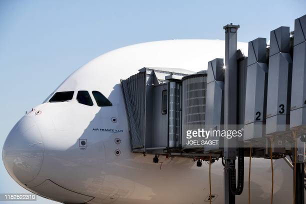 This picture taken on June 27, 2019 shows the cockpit of an Airbus 380 of the of the airline company Air France parked in the tarmac at...