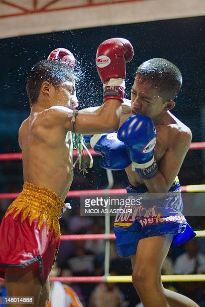 This picture taken on June 28 2012 shows young Muay Thai boxers fighting in the ring at a boxing stadium in Buriram province in the northeastern...