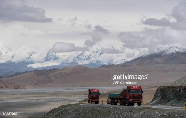This picture taken on June 28 2017 shows trucks driving along the ChinaPakistan Friendship Highway before the Karakorum mountain range near...