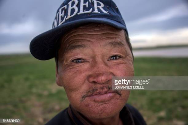 TOPSHOT This picture taken on June 29 2016 shows herder Zandraagiin Budjav who works with herder Pagvajaviin Shatarbaatar posing for a picture in the...