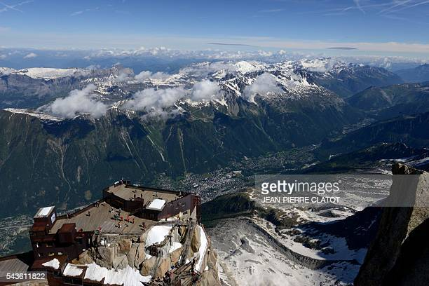 This picture taken on June 29 2016 shows the MontBlanc peak at the top of the Aiguille du Midi mountain above Chamonix French Alps / AFP / JEANPIERRE...