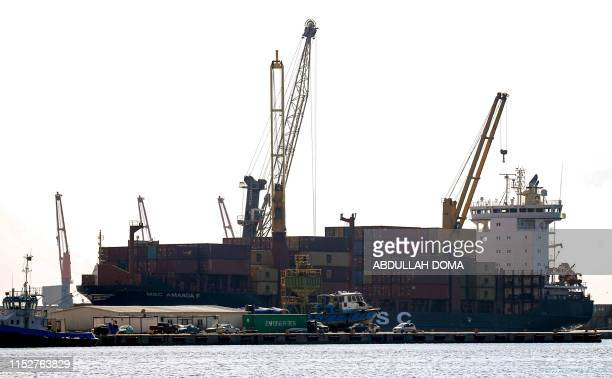 This picture taken on June 29 2019 shows a view of a container ship moored in the harbour of the eastern Libyan port city of Benghazi