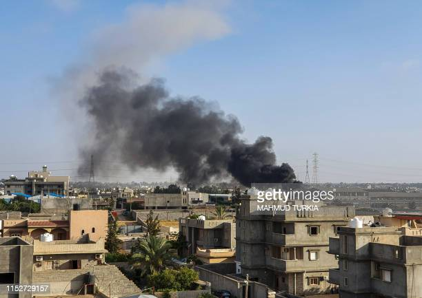 This picture taken on June 29 2019 shows smoke plumes rising in Tajoura south of the Libyan capital Tripoli following a reported airstrike by forces...