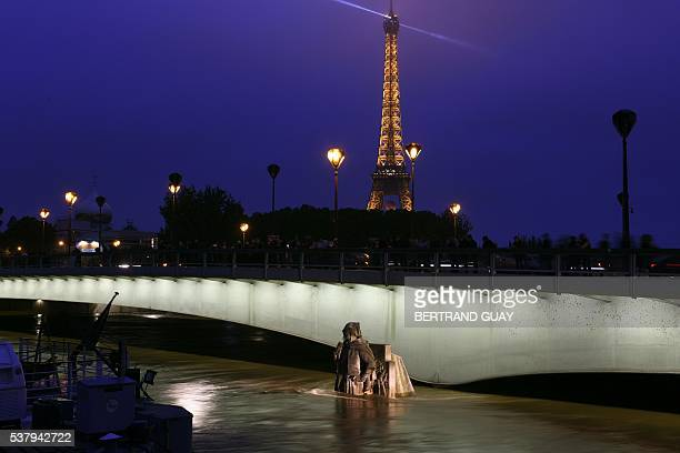 TOPSHOT This picture taken on June 3 2016 shows the Zouave statue of the Alma bridge flooded by the river Seine by the Eiffel tower following heavy...
