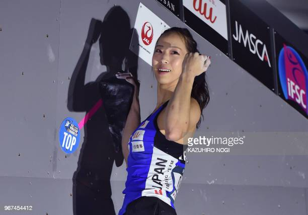 This picture taken on June 3 2018 shows Japanese Olympic medal hope Akiyo Noguchi celebrating at the Climbing World Cup women's bouldering...