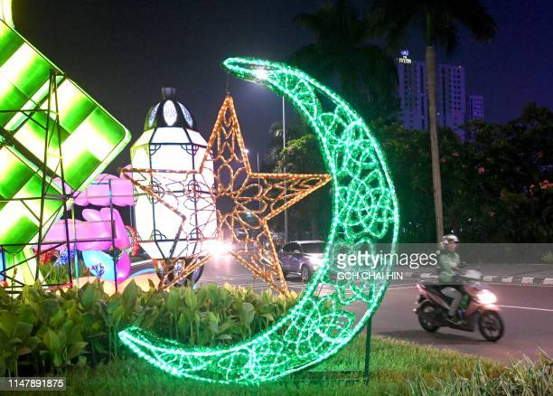 This picture taken on June 3, 2019 shows decorations on a street in Jakarta as people start to head to their hometowns to celebrate Eid al-Fitr. -...