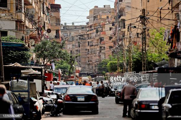 This picture taken on June 3, 2020 shows a view of a street in the Bab al-Tabbaneh neighbourhood of Lebanon's northern city of Tripoli. - Thousands...