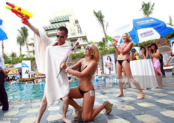 This picture taken on June 30 2012 shows foreign tourists during a bikini beach party in Sanya southern China's Hainan province The growth of China...