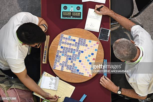 This picture taken on June 30 2016 shows participants playing a game of Scrabble during the King's Cup tournament the globe's biggest Scrabble...