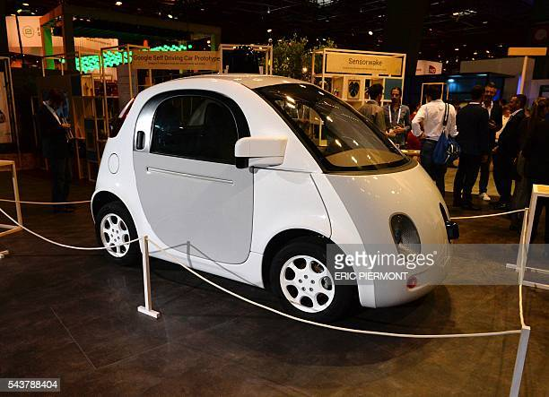 This picture taken on June 30, 2016 shows the Google's self driving car project on the Google stand at the Viva technology event in Paris. / AFP /...